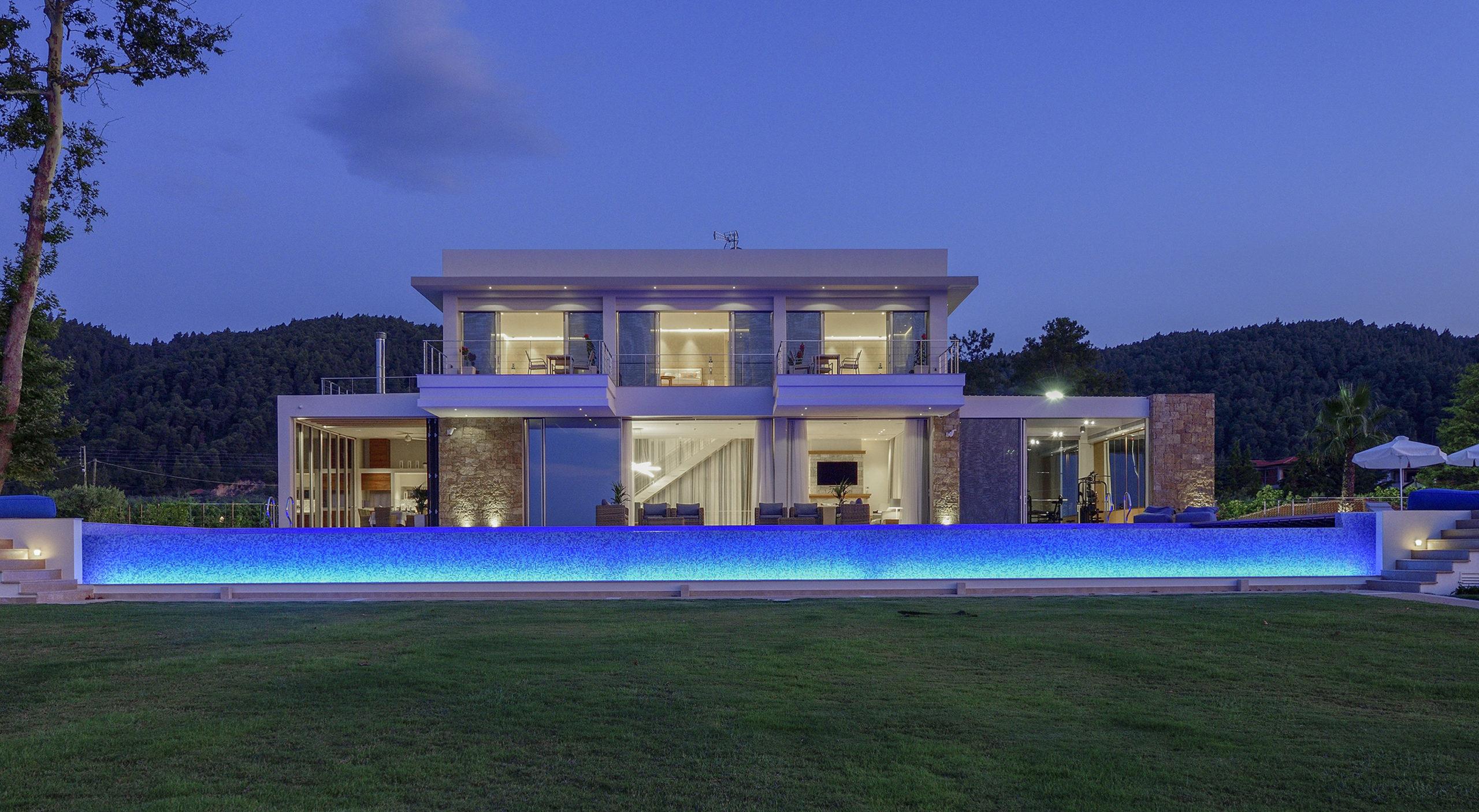 Villa Natalia Front photo sunset with lights on blue pool